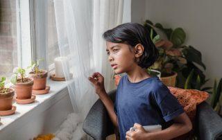 child waiting - window - gate